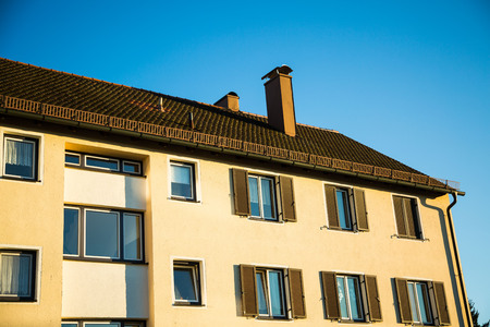 multifamily: Multi-family house in Munich, blue sky Stock Photo
