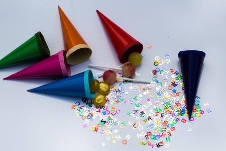 Multi coloured cones, lollipop and alphabets. Stock Photo