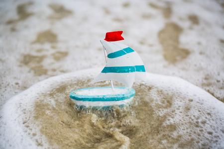 Sailboat at sea, miniature sailing boat, holiday, symbolic, romantic