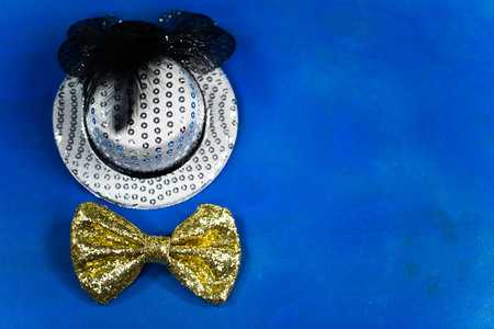 hat and bow tie, blue background, party, carnival, New Year's Eve 写真素材