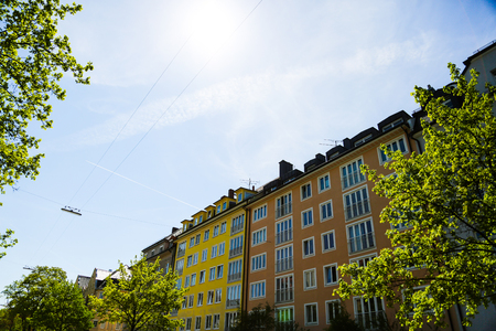 Residential houses, row of houses in Munich, beautiful residential area, blue sky Stock Photo