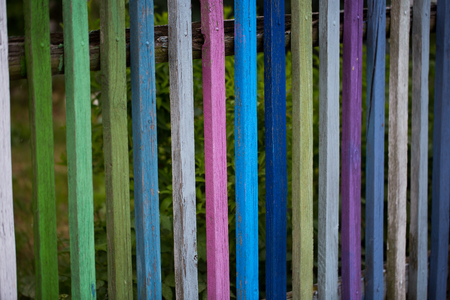 Wooden garden fence colorfully painted