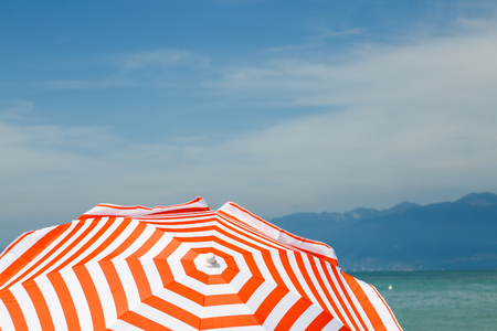 red white parasol on Lake Garda