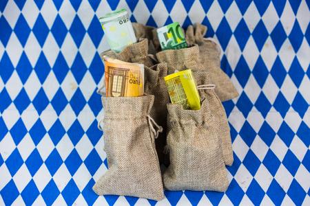 Money sacks on white background, bavarian rhombuses, money, money bag filled with euro