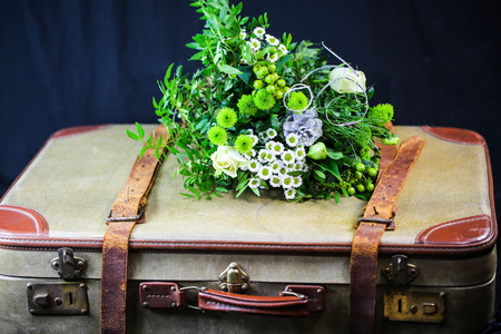 old suitcase with bunch of flowers