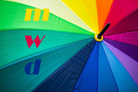 umbrella with rainbow colors, m, w, d, letters for male, female, diverse