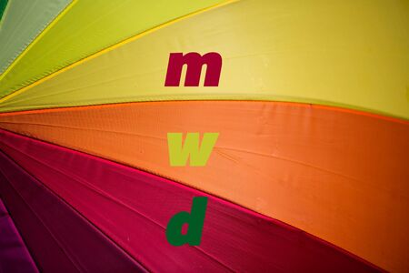 Umbrella with rainbow colors, m, w, d, letters for male, female, miscellaneous 版權商用圖片