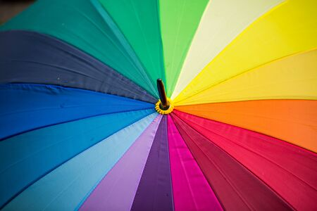 Umbrella with rainbow colors, symbolic,