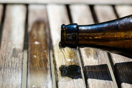 Beer bottle lies on table and ends, Fathers Day