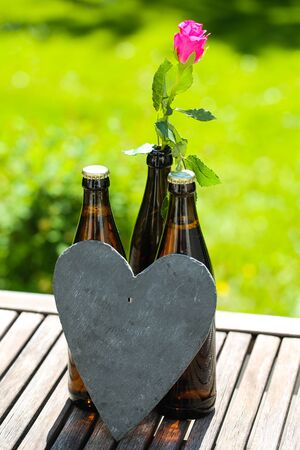 Beer bottle with heart and roses for Father's Day 版權商用圖片 - 131099827