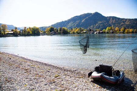 Fishing on Tegernsee in autumn, sunny day 版權商用圖片 - 131926062