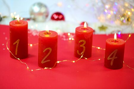 burning candles on red background, christmas background