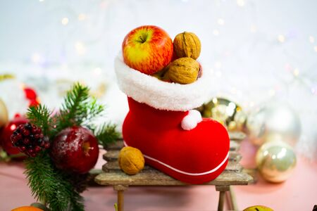 Santa boots filled with nuts and apples, decoration