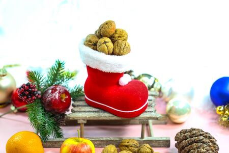 Santa boots filled with nuts, decoration 版權商用圖片
