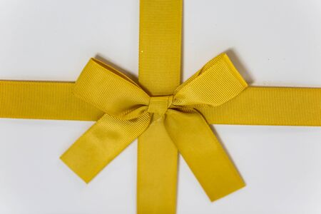 Gift with gold ribbon, macro, closeup, christmas