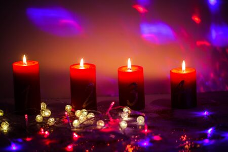 Candles for Advent with fairy lights 版權商用圖片