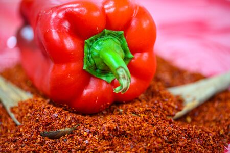 Pepper on paprika flakes