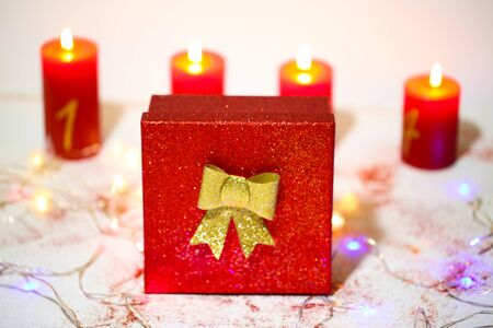Gift for christmas with fairy lights and candles