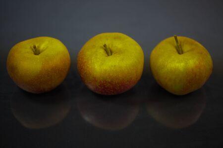 boskop apples on black background