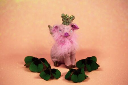 Lucky pig on pink background with shamrocks,  talisman