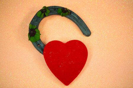 Horseshoe with a heart and shamrocks