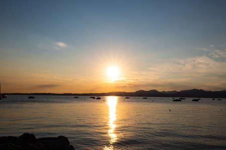 Sunset in Bardolino on Lake Garda with mountains in the background Standard-Bild