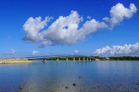 Old Vir bridge that connects the island with the mainland. Beautiful view, blue sky, white clouds Archivio Fotografico