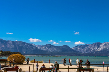 south lake tahoe: People enjoying the sun and sand on the beach of South Lake Tahoe, California