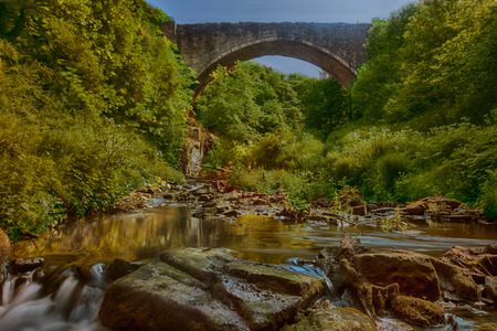 The Causey Arch is a bridge near Stanley in County Durham, northern England. It is the oldest surviving single-arch railway bridge in the world, and a key element of the industrial heritage of England.It was built in by stonemason Ralph Wood, funded by a  Stock Photo