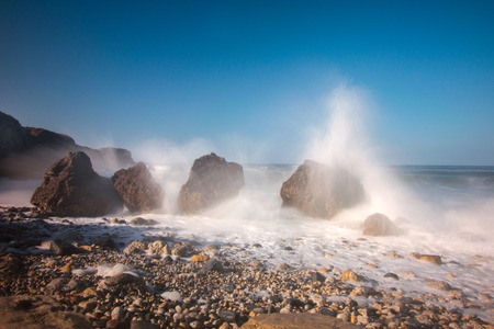 Graham: a spring tide brings in a rough sea on graham sands in south shields and the waves crash over the top of the four sisters Stock Photo