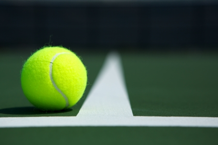 individual sport: Tennis Ball on the Court Close up