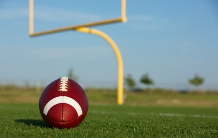 American Football with the Goal Posts or Uprights in the Background photo