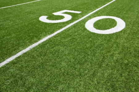 youth football: Fifty Yard Line of a Football Field with room for copy Stock Photo