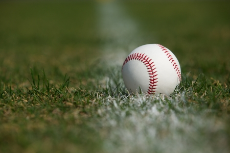 Baseball in the Outfield Grass and Chalk Line Stock Photo - 17729195