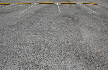 unoccupied: Empty Parking Spaces with room for copy