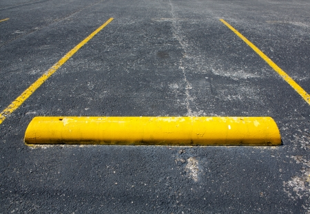 Old Worn Empty Parking Space with room for copy photo