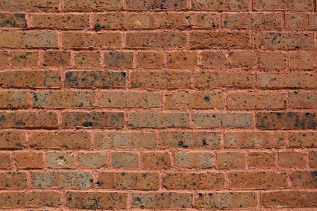 19th century: Worn Early 19th Century Brick Wall for Industrial Background Stock Photo