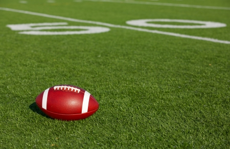 youth football: American Football on the Field near the Fifty Yard Line