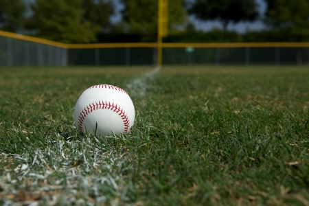 outfield: Baseball on the Outfield Chalk Line Stock Photo