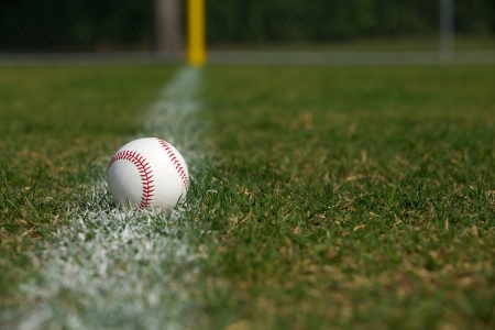 outfield: Baseball on the Outfield Chalk Line with room for copy