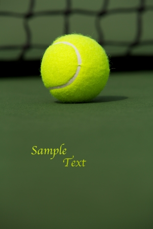 Tennis Ball isolated on the court with room for copy Imagens