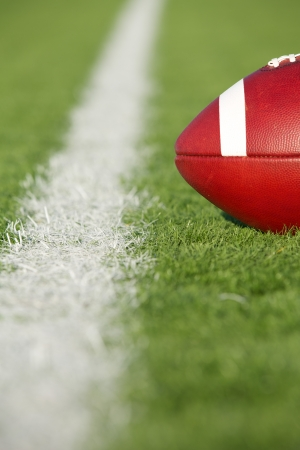 inches: American Football on the Field at Fourth and inches to first down Stock Photo