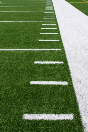 football background: Yard Lines of a Football Field Vertical Stock Photo