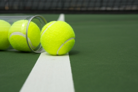 Tennis Balls from a Canister on the Court with room for copy