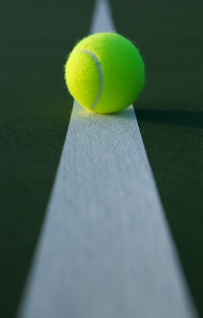 Tennis Bal Centered on the Court Line with room for copy