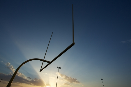 football goal post: American Football Goal Posts or Uprights at Sunset Stock Photo
