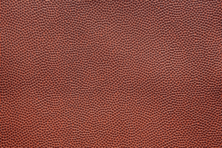 pigskin: American Football Texture Close Up for Sports Background