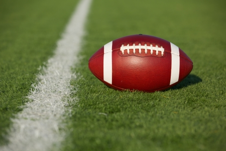 American Football on the Field with room for copy Stock Photo