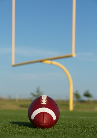 youth football: American Football on the Field with the Uprights Beyond