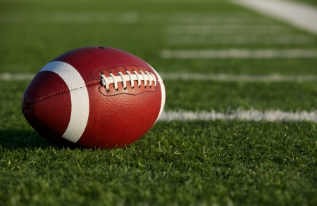 american football: Collegiate Football on the Field with room for copy Stock Photo